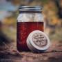 apple pie moonshine jar and tin on path c2